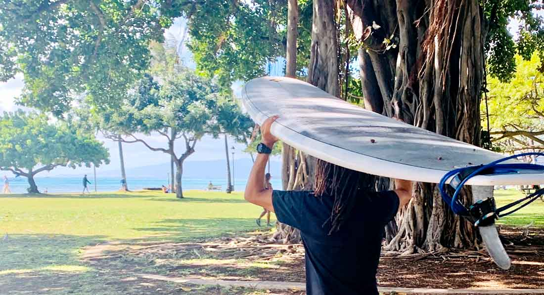 Sean Anderson Carrying Surfboard Down to Beach at Kapiolani Park